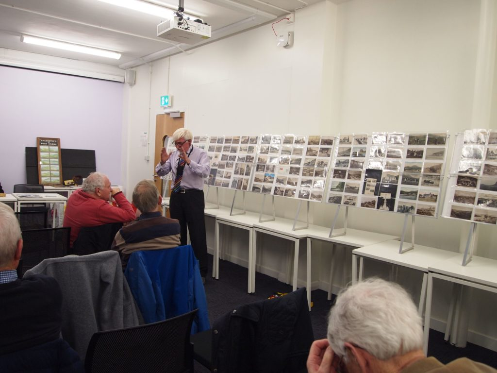Arran postcards are explained to the audience.