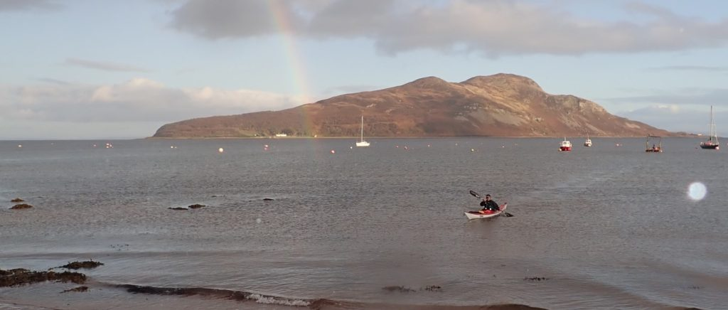 Fiona Clarke returns to shore after kayaking around Holy Isle.