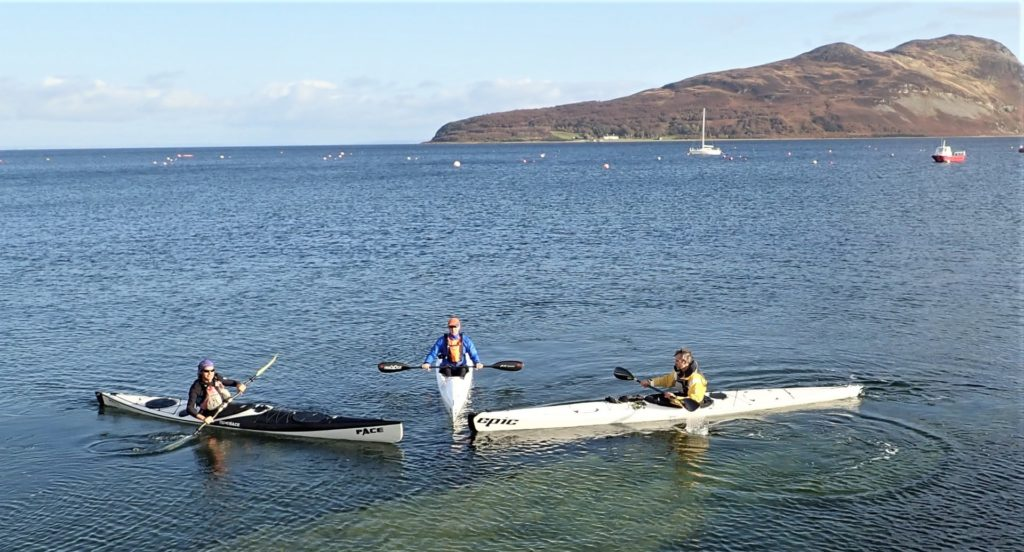 The three kayakers prepare to set off on the Kayak Club Holy Isle Challenge.