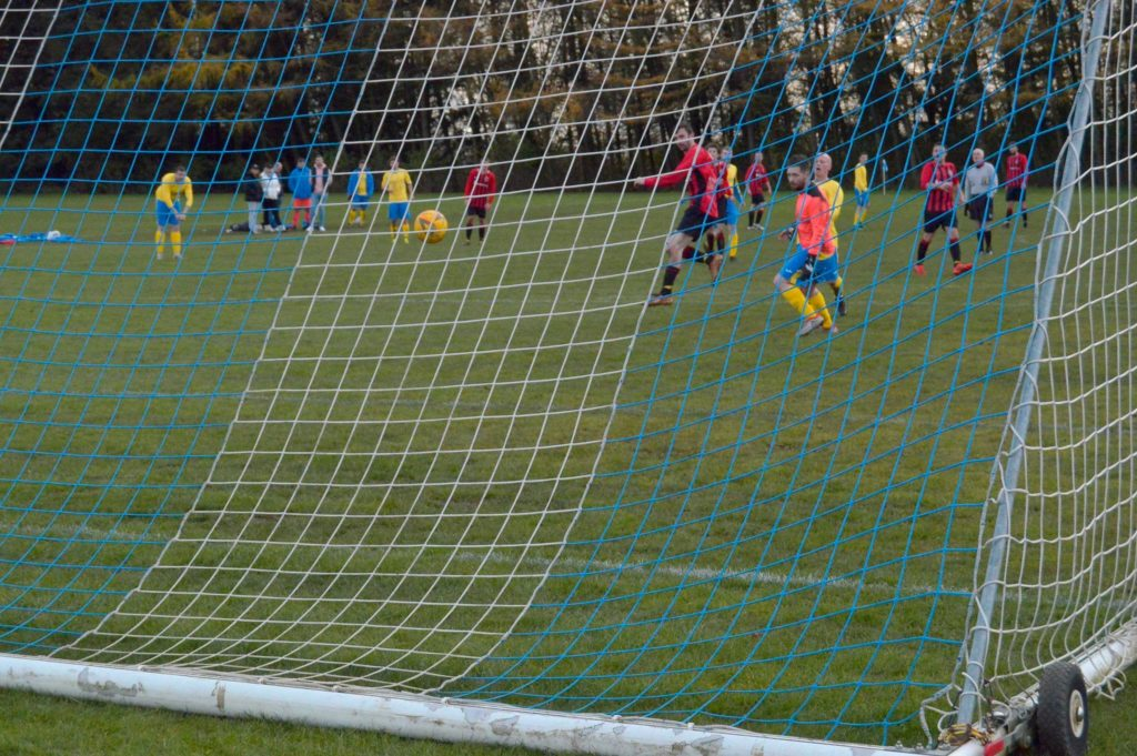 Archie McNicol takes advantage of an undefended goal to blast the ball straight into the net.