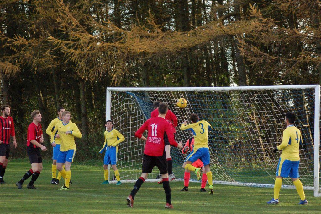 Grant Adamson heads the ball into the Glencairn goal.