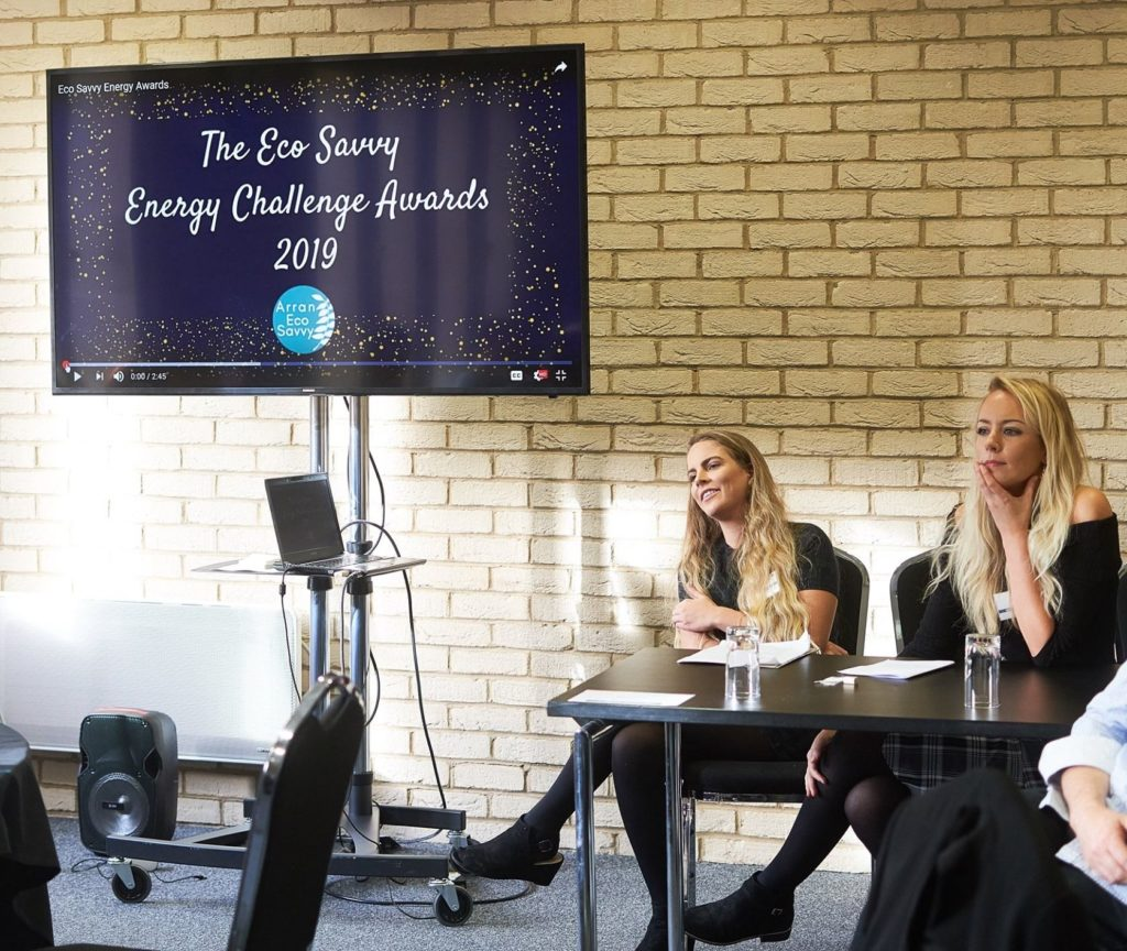 Eco Savvy's Jude King and Charlotte Mann engage in a discussion during the Scottish Government Climate Challenge Fund gathering.