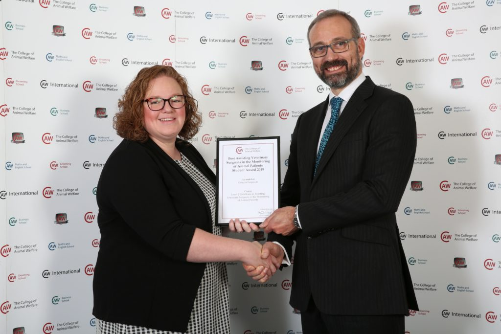 Gemma Ferguson is presented with her award for being the best student in her class at the College of Animal Welfare.