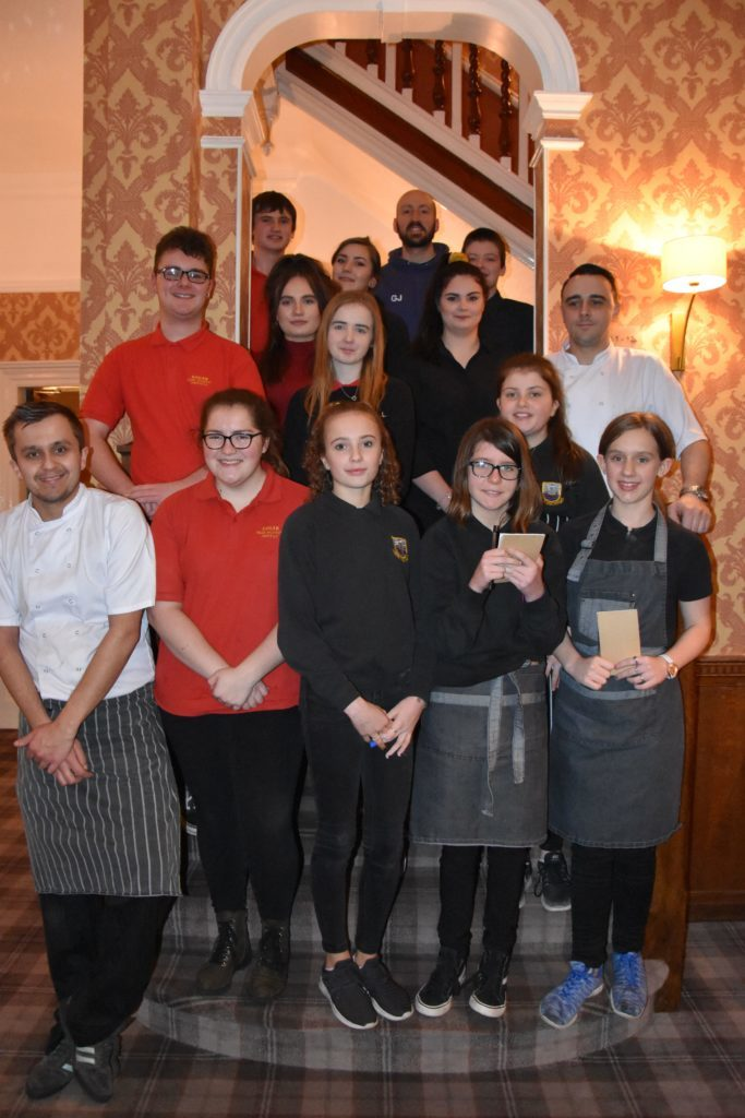FEBRUARY. Serving up a feast for invited guests were the members of the Arran Youth Foundations, pictured with Auchrannie chefs, who helped prepare and serve a meal during their annual restaurant night.