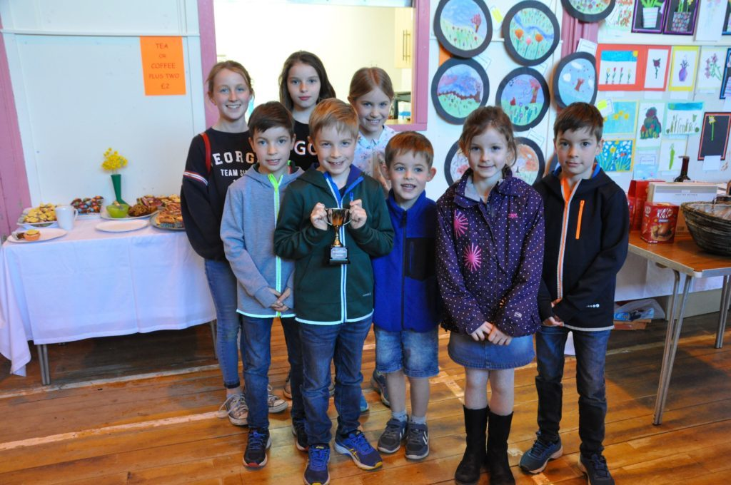 APRIL. Brodick primary pupils beam with delight at taking the Brodick Castle Gardens Trophy for the school gaining the most points in the Spring Flower and Bulb Show held by the Arran Horticultural Society.
