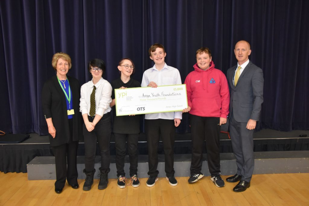 MAY. Youth Philanthropy Initiative representative Isabel Johnstone is pictured with Alice Lockhart, Gordon Bloy, Lewis Swandells, Cameron McNeish and head teacher Barry Smith with a cheque for £3,000 which they won for the Arran youth Foundations.