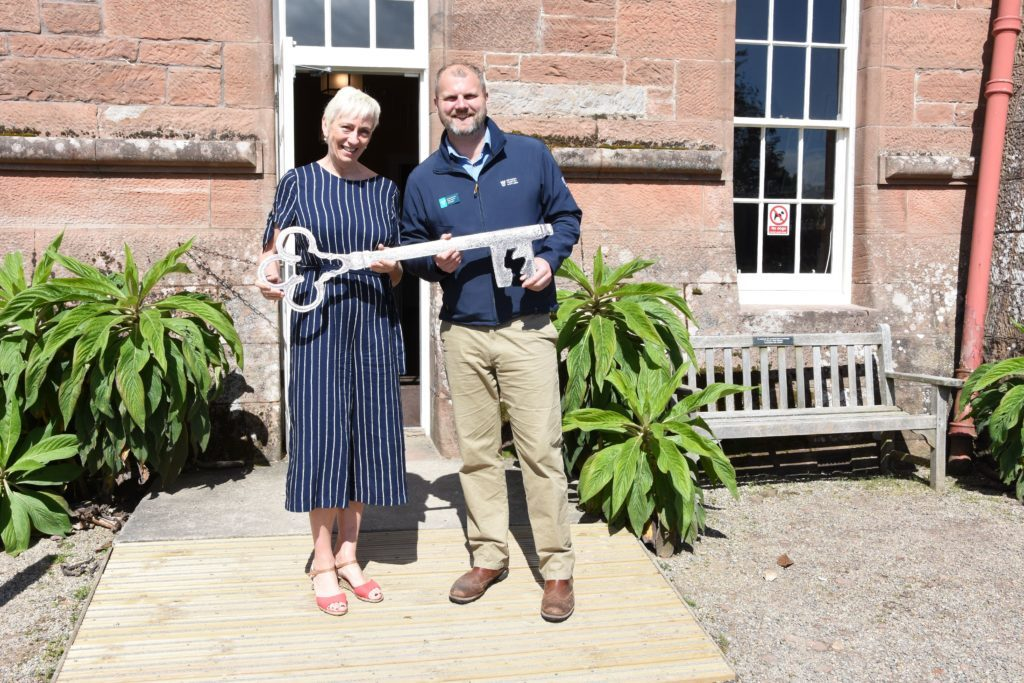 MAY. Although already open to the public Brodick Castle held an official opening event with invited VIP guests and representatives of island business. Pictured are Sheila Gilmore of Visit Arran and Jared Bowers of the NTS officially opening the castle.