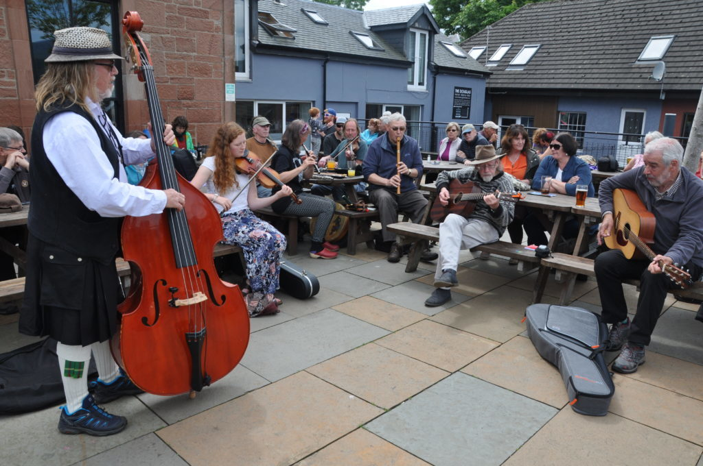 JUNE. A collective of musicians entertain an appreciative audience at the 25th annual Arran Folk Festival. 01_B24folk01
