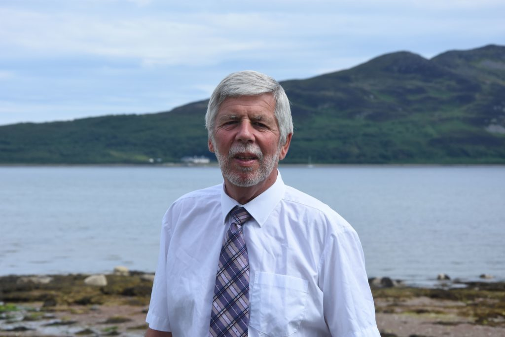 JUNE. Retiring island officer Gus Macleod pictured on his last day of work after nearly three decades with North Ayrshire Council.