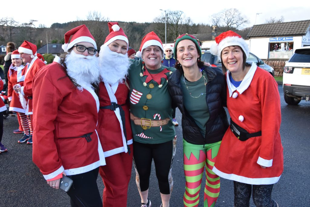 Ready to run: faculty members of Brodick Primary School prepare to set off.