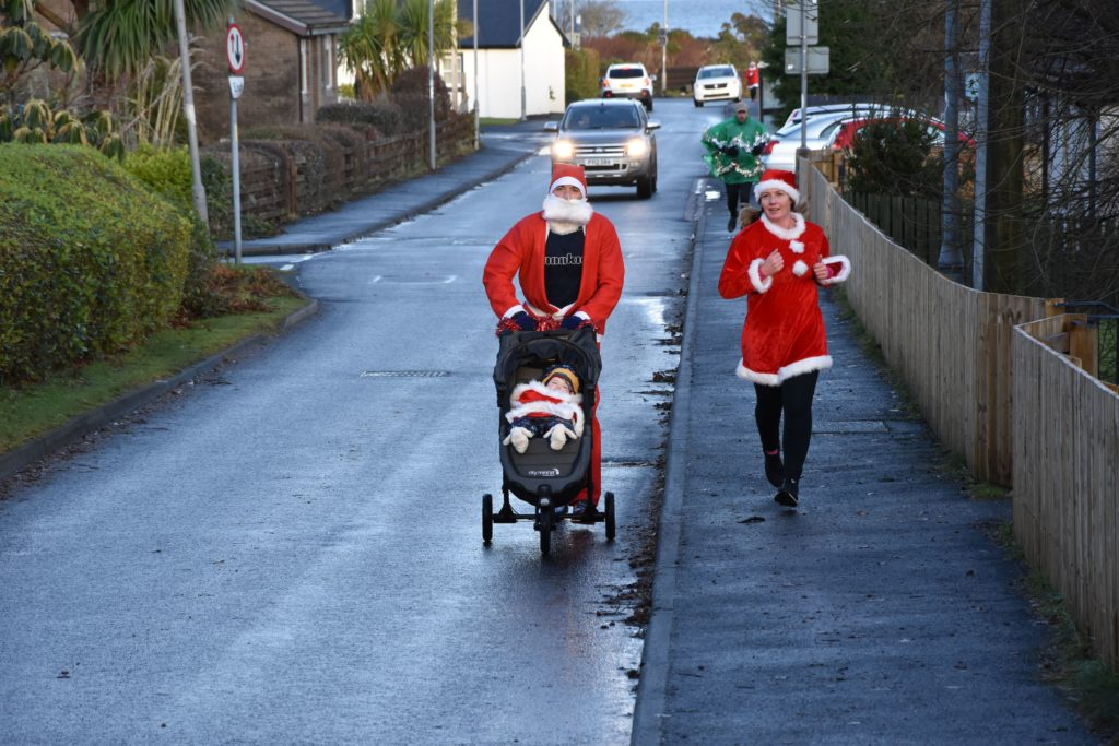 Leading the pack, the Webb family begin the slight incline up Auchrannie Road.