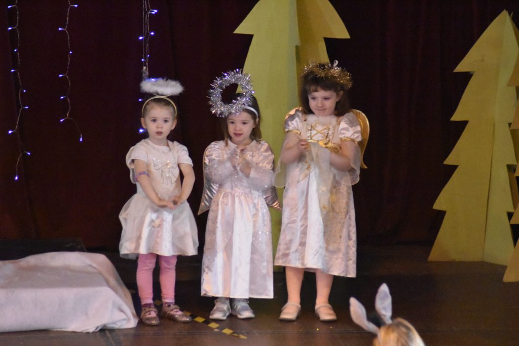 Three little angels watch over the proceedings.
