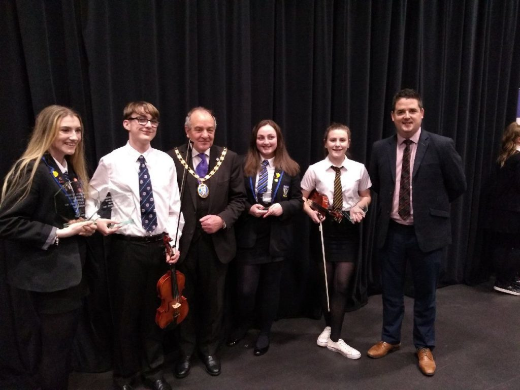 FEBRUARY. Arran winners and runner ups in the S4 to S6 section of the North Ayrshire traditional musician of the year competition were, l to r, Rachel Lawson (winner), Reece O'Halon (winner), Anna Reid (runner up) and Charlotte McKillop (runner-up) with adjudicator Gordon Bruce and Provost Ian Clarkson.