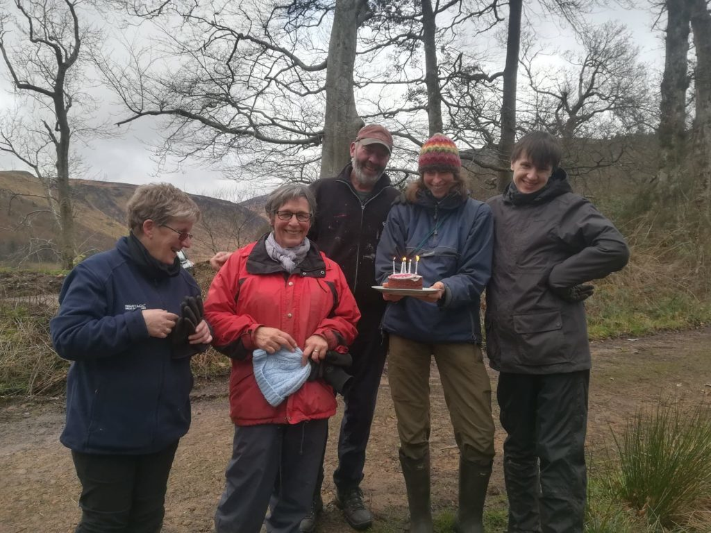 MARCH. Members of the Healthy Outdoors Team celebrate their seventh birthday with a cake, enjoyed outdoors in a copse near Glen Rosa.
