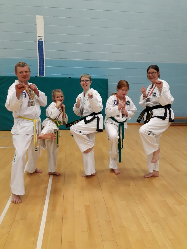 MARCH. Five Arran Taekwondo students show off their skills that earned them 16 medals at a recent competition in Edinburgh.