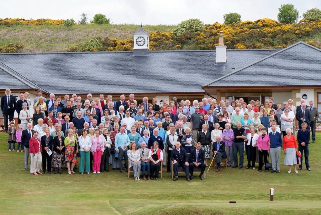 The May image shows the opening day of the new clubhouse attended by past captains, members and others that were involved in its creation.