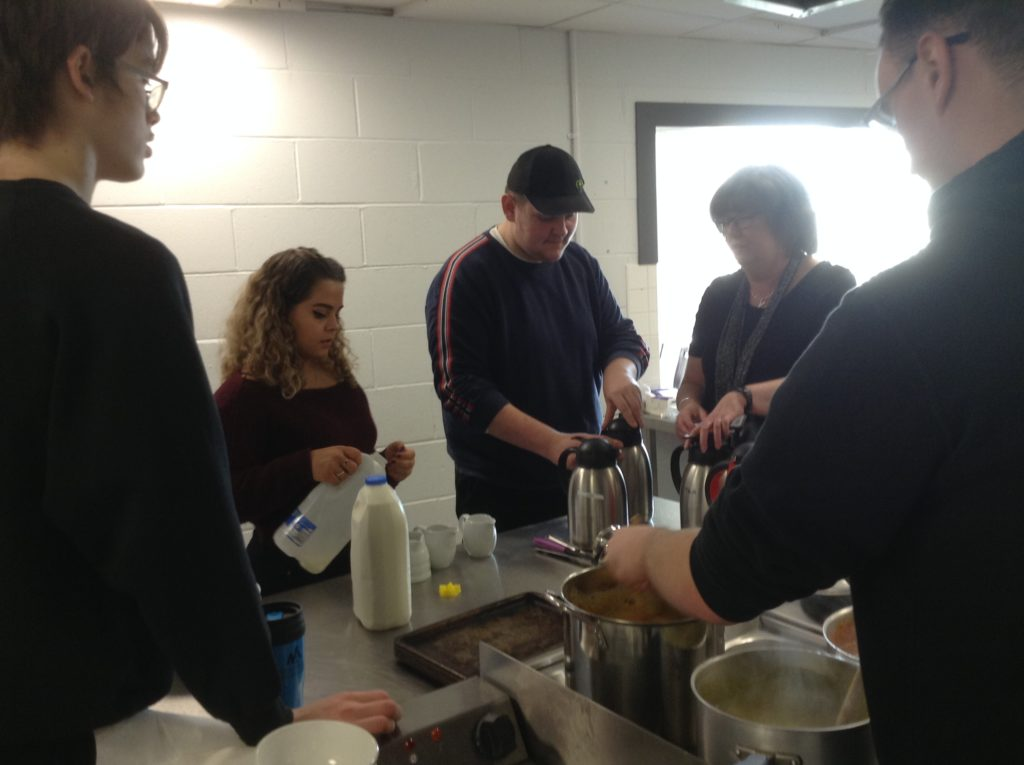Pupils prepare drinks and food for their guests.