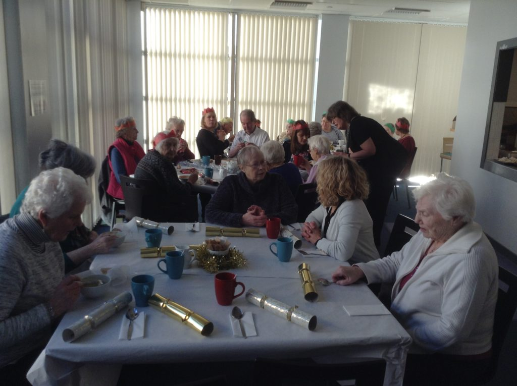 Guests enjoy a festive lunch at the Arran High School cafeteria.