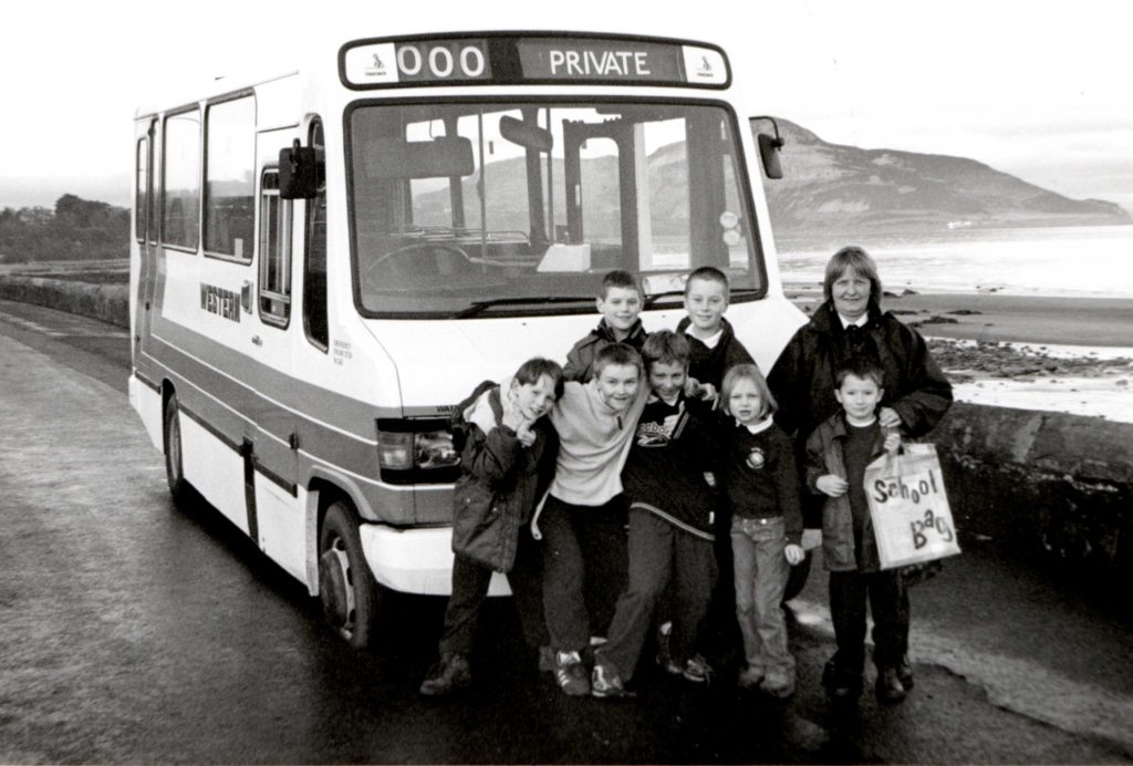Bus driver Morag McQueen with her young charges whom she had just rescued from a sinking bus.
