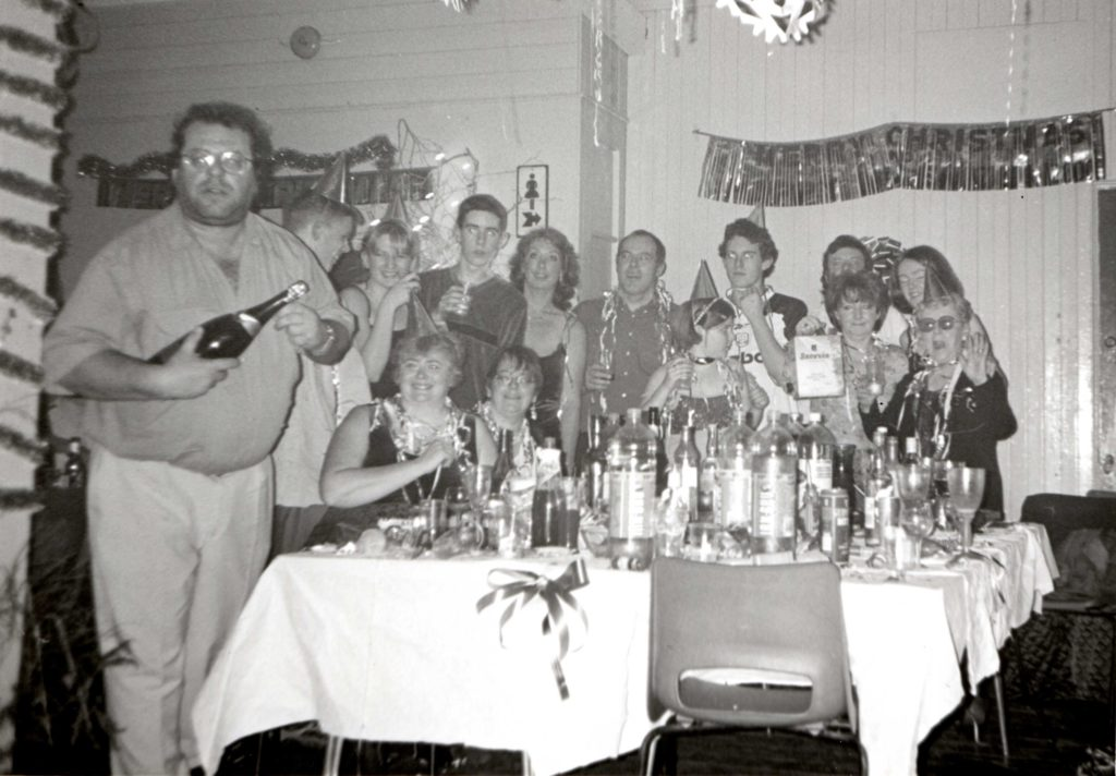 Colin Davidson uncorks a bottle of champagne at the Lamlash Hogmanay Party where revelers celebrated the millennium.