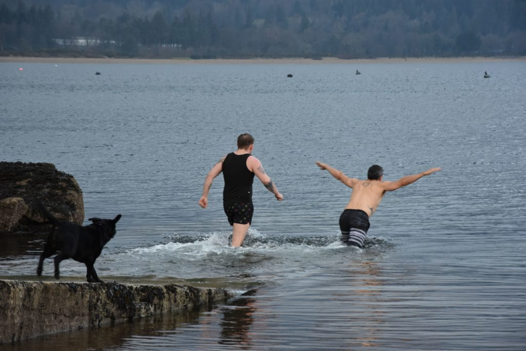 The first two brave swimmers enter the water.