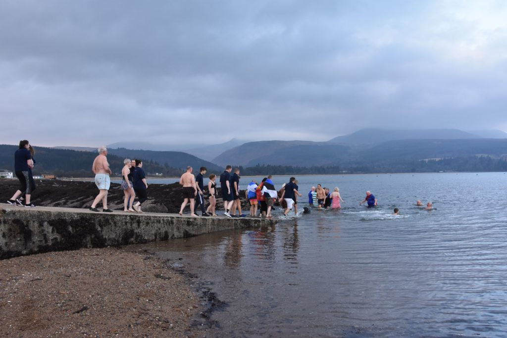 With temperatures hovering at eight degrees swimmers slowly make their way to the water.