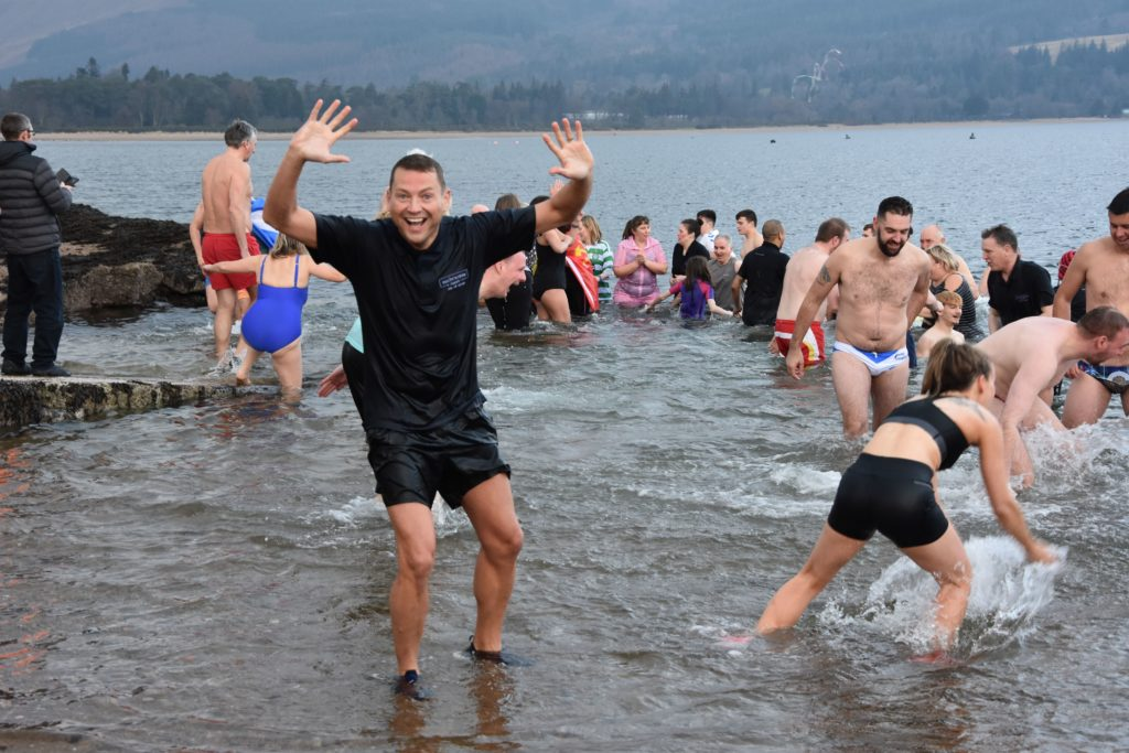 A smiling Richard Small of the Auchrannie Hotel emerges from the water.