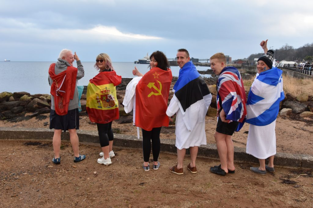 Douglas Hotel organisers and staff with their flags in memory of hotel owner Sean Henry.
