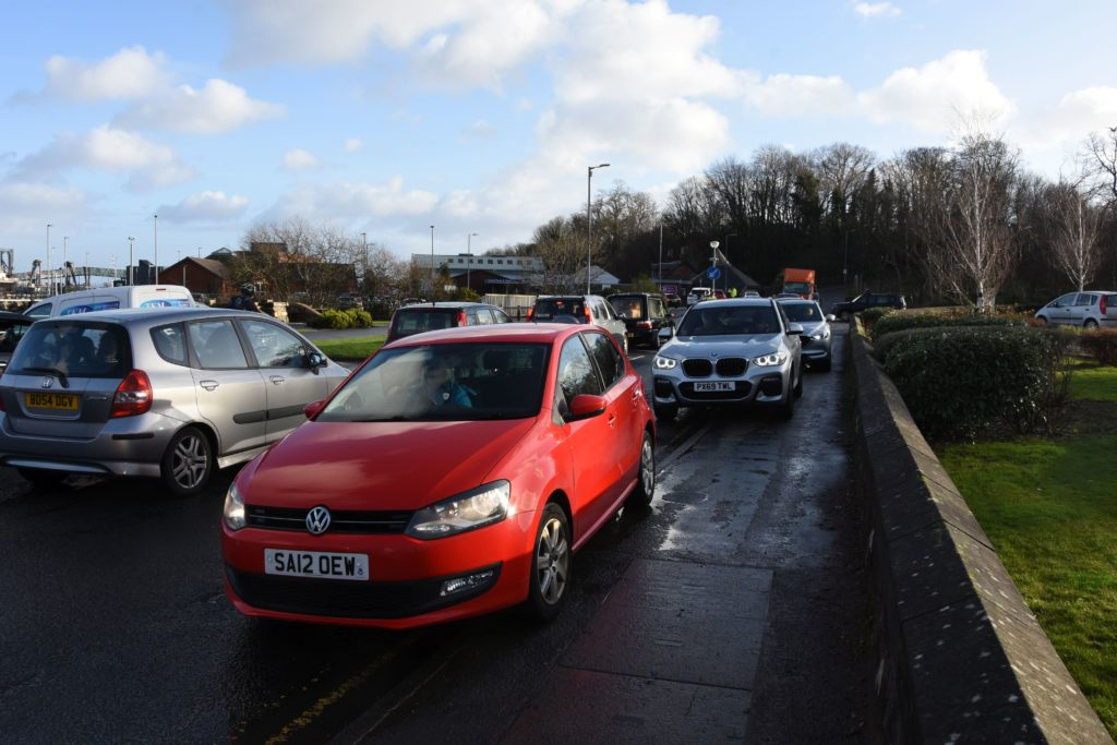 Cars block the pavement after being turned away from the ferry in Brodick last Friday.