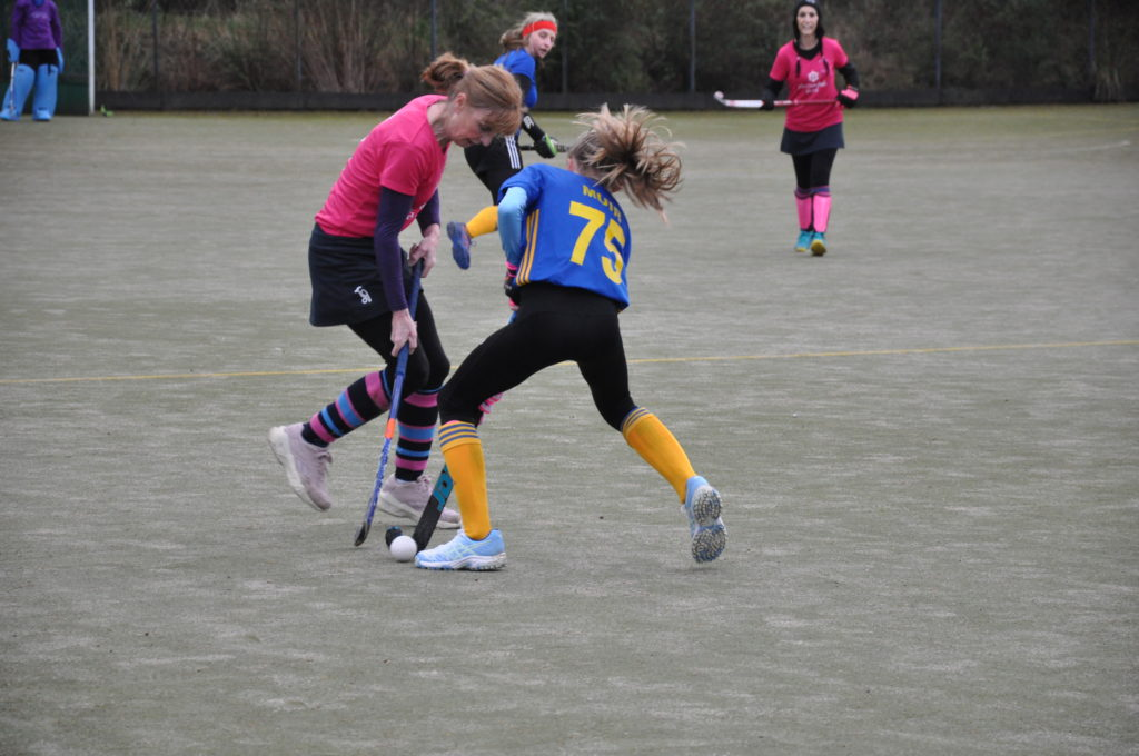 Susie Murchie steps in to block a pass.