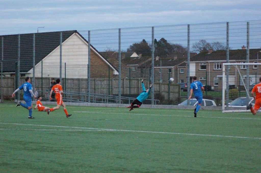 Archie McNicol fires the ball past the flying Killie keeper for goal number two.