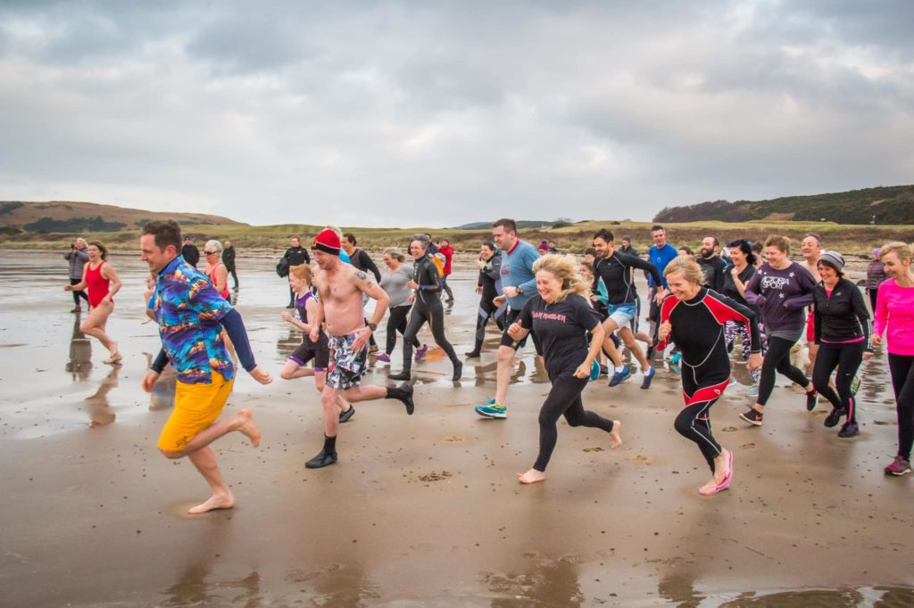 On your marks, dookers charge into the freezing cold water at Blackwaterfoot. Photograph: Andy Surridge.