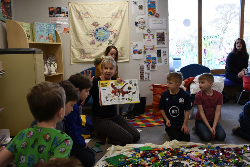 Librarian Jane Greenstreet shows the participants a Lego model that helps to inspire the children and give them ideas for their own creation.