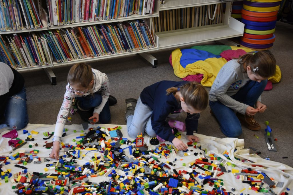 Children sift through a huge assortment of blocks to find the correct piece for their projects.