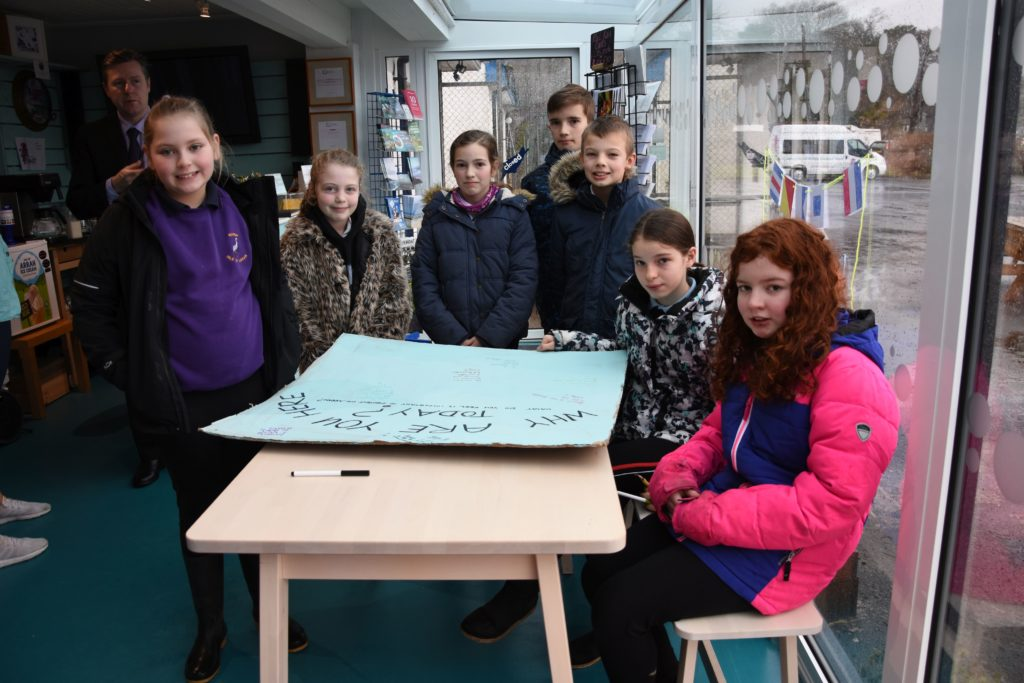 The Arran Eco Savvy Schools' Committee, with a representative for each school on Arran, make a poster explaining why they are striking.