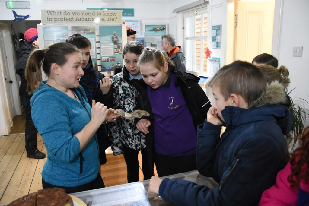 Pupil attending the strike get an update from outreach officer Jenny Stark on what animals are currently being accommodated in the COAST live tank.