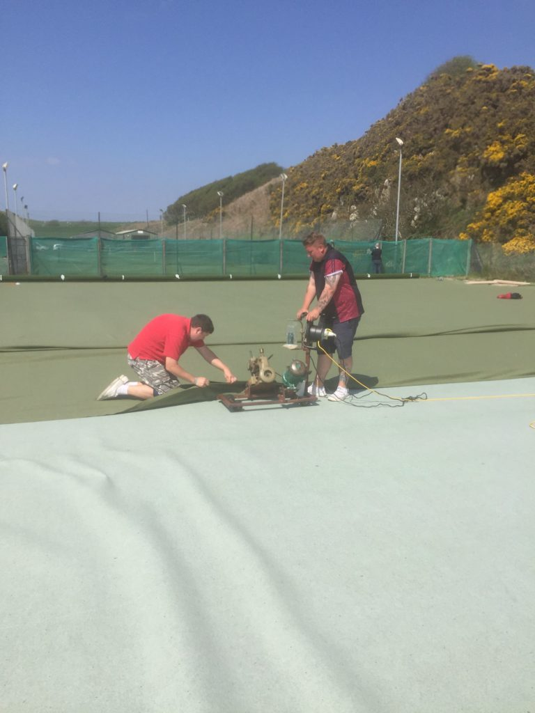 Carpet laying, outdoor style!