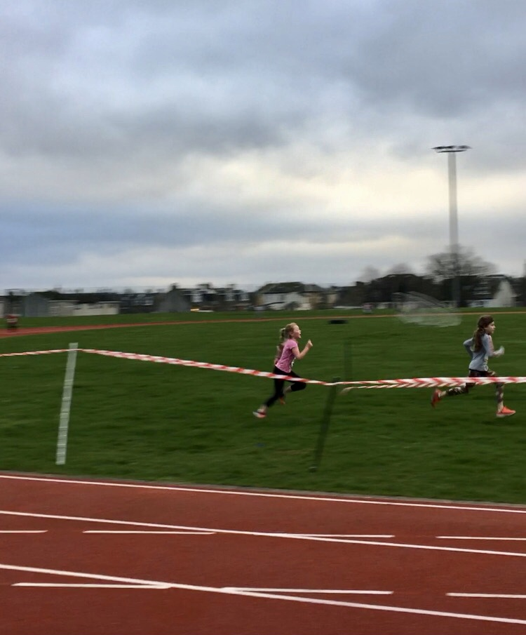 Isla McKinnon powers towards the finish line just behind Julieta Gray in the P5 girls race.