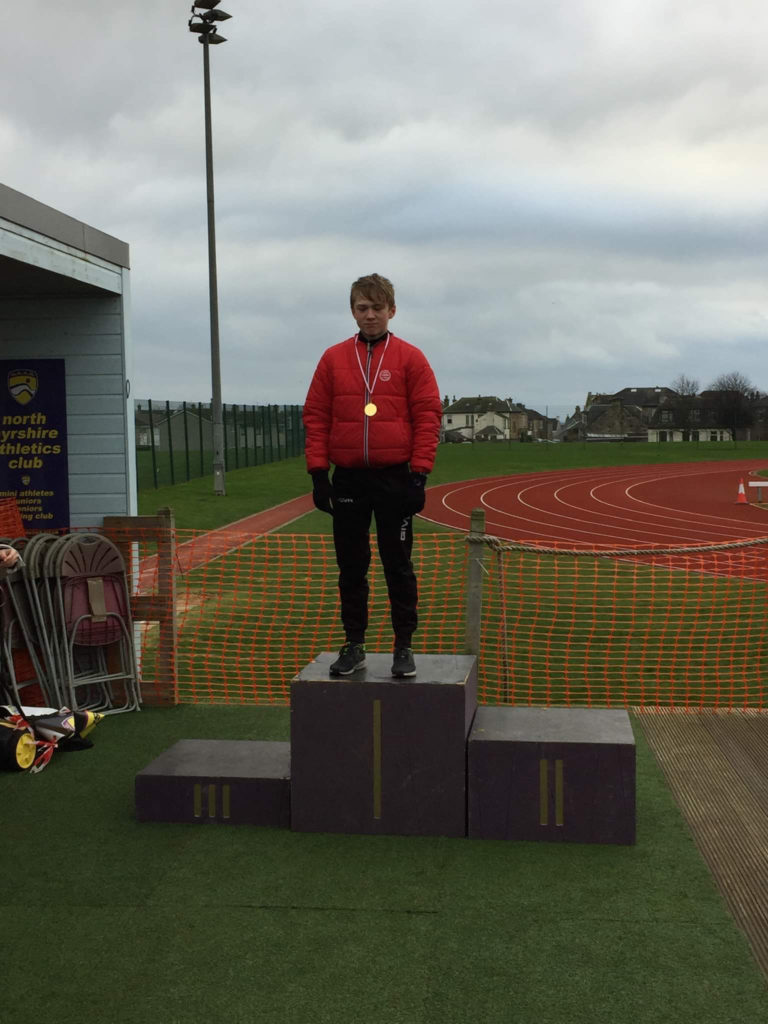 Ruaridh Lindsay Smith with his gold medal for his performance in the boys S2 race.