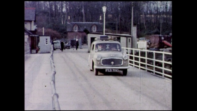 A car makes its way on Brodick's old pier towards the ferry.