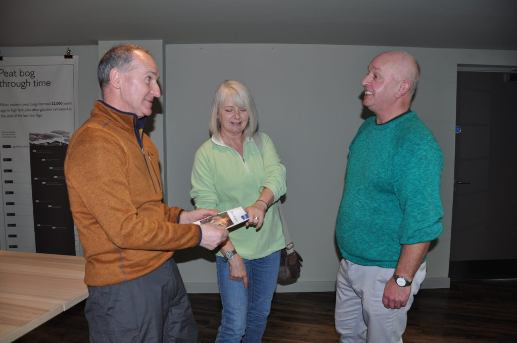 Terry Southall, right, chats about birds to John and Jean Fitzpatrick, who both work at the distillery.