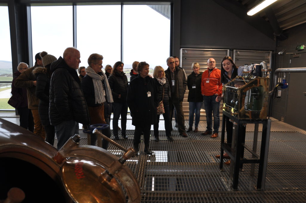 Visitors enjoy a guided tour of the distillery.