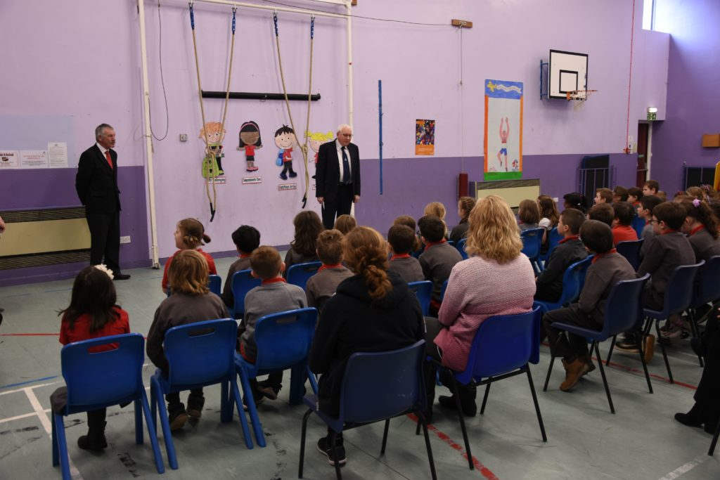 Children listen attentively during a special assembly at Lamlash Primary to hear if their picture was selected as the winning entry.