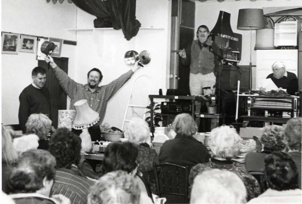 Peter Sloan shows off the goods while Jim Lees leads the bidding at the Corrie and Sannox Harbour Trust auction. Not just an opportunity to pick up a bargain the auction also provides much entertainment.