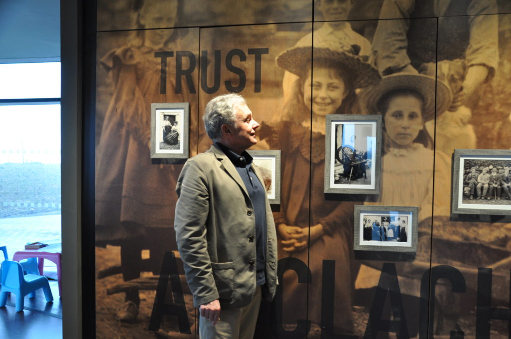Roddie Thompson looks at the photograph of his grandmother.