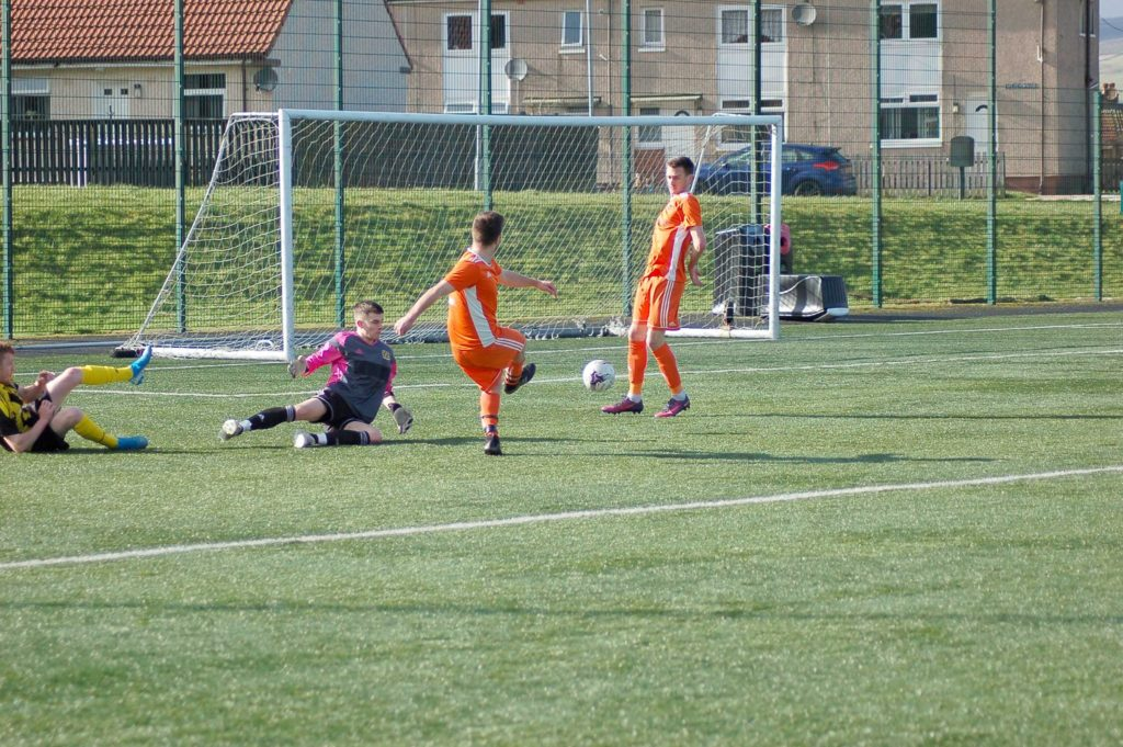 Christopher 'Babbies' McNeil seizes an opportunity to score for the Arran side.