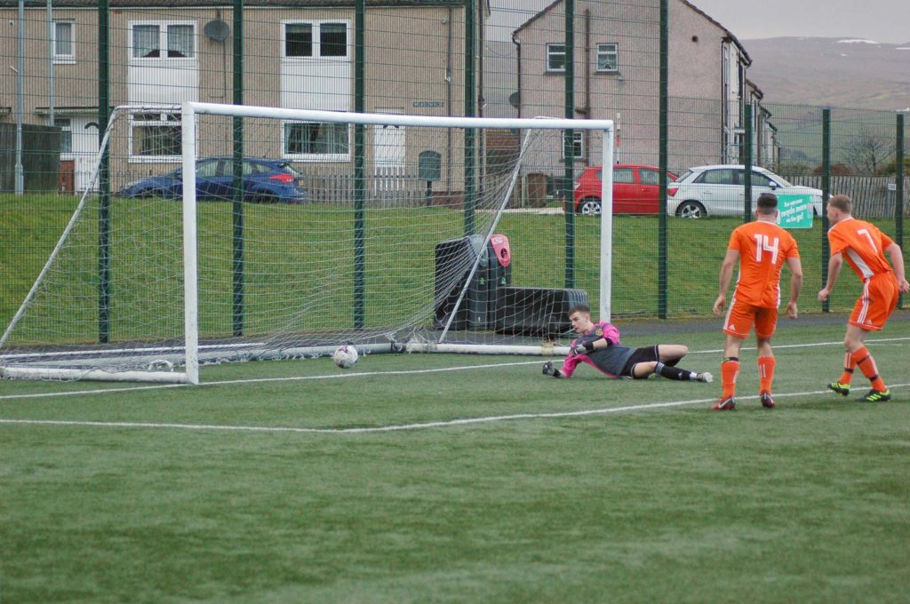 Donald Park delivers a powerful goal right in front of the opposition keeper.