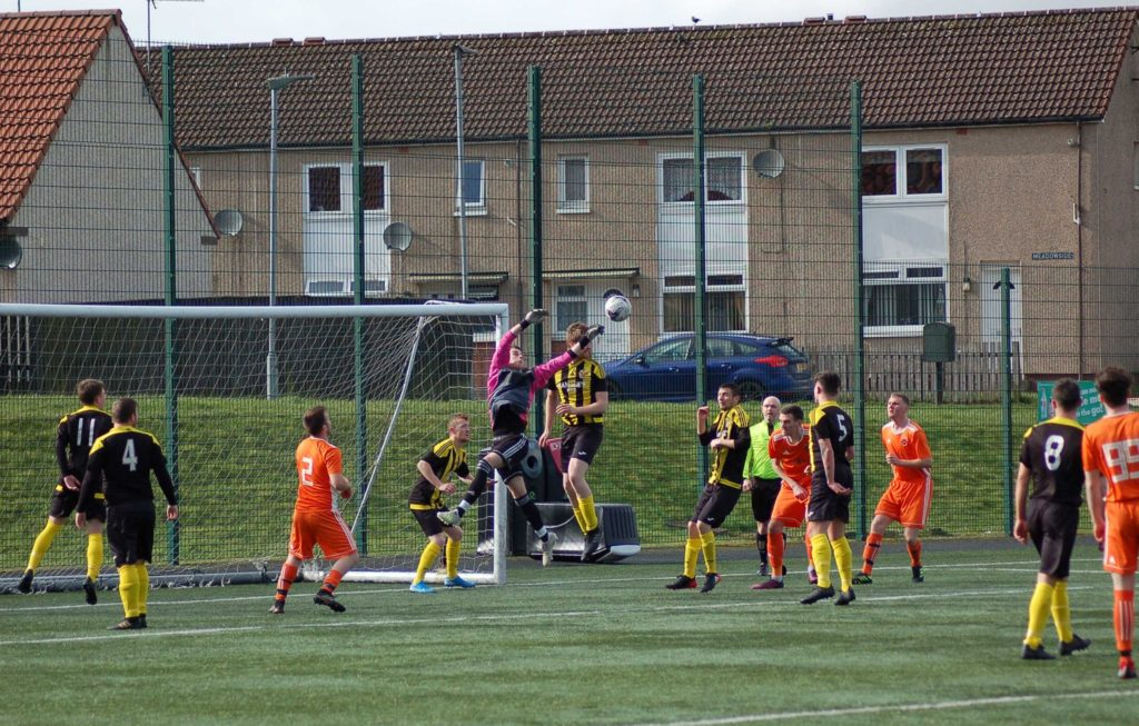 The Kilbirnie keeper makes an impressive leap into the air to prevent an Arran goal.