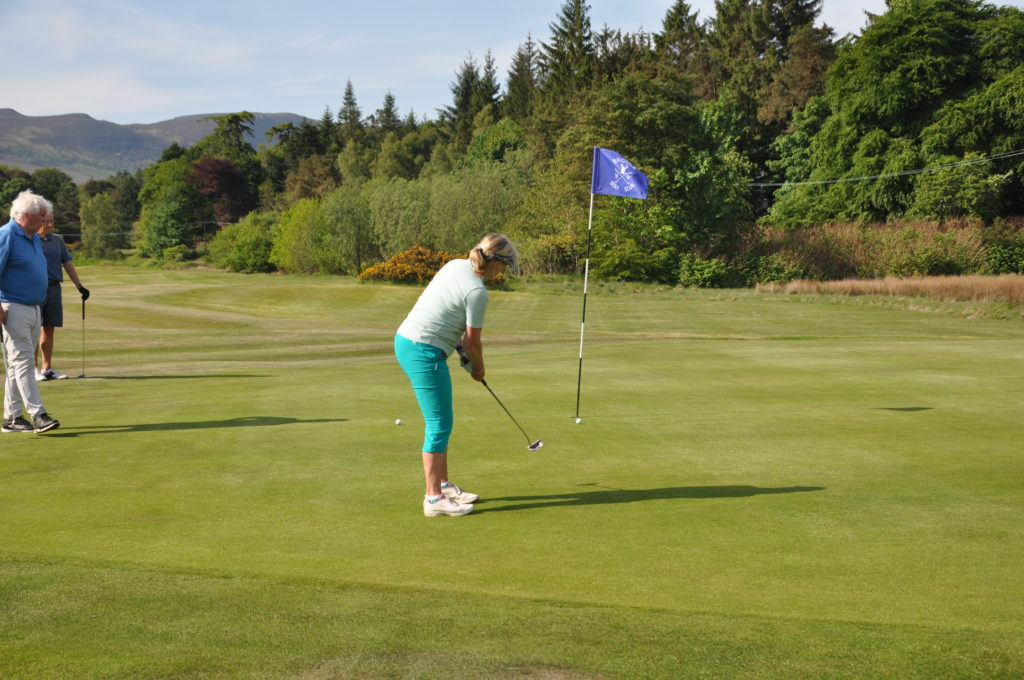 Brodick captain Ann May putts out at the 10th on her first round since lockdown began.