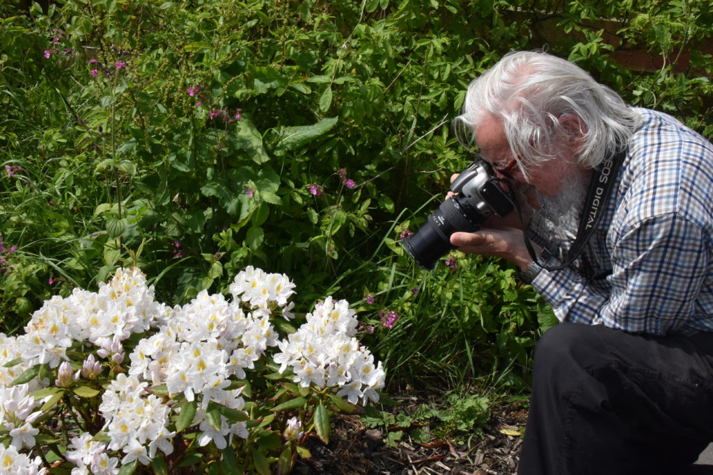 George Christie takes a picture with a macro lens. N